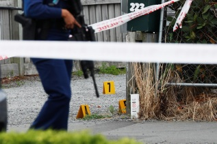 Police guard the site of Friday's shooting undergoing investigation, outside the Linwood Mosque, in Christchurch